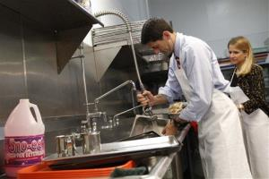 Paul Ryan and his wife Janna wash pots at the St. Vincent De Paul dinning hall in Youngstown, Ohio.