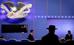 Hofstra Public Safety officer Ronald Nardo watches as stand-ins  run through a rehearsal ahead of tonight's debate.