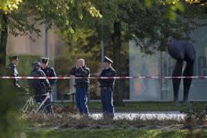 Police officers guard a cordoned off area at the rear side of the Kunsthal museum in Rotterdam, Tuesday Oct. 16, 2012.
