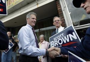 Republican Sen. Scott Brown, R-Mass., shakes hands as he campaigns for re-election in Woburn, Mass., Oct. 15, 2012.
