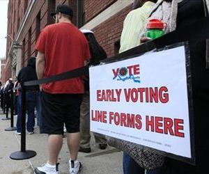 Voters stand in line outside the Hamilton County Board of Elections just before it opened for early voting, in Cincinnati, Oct. 2, 2012.