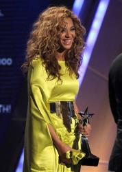 Beyonce accepts the award for video director of the year at the BET Awards on Sunday, July 1, 2012, in Los Angeles.