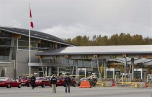 Police investigate the scene of the shooting at the Blaine, Wash./Surrey, BC border crossing yesterday.
