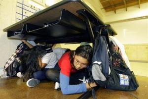 In this 2009 file photo, children participate in the Great California ShakeOut earthquake drill at the Para Los Ninos Elementary School in Los Angeles.