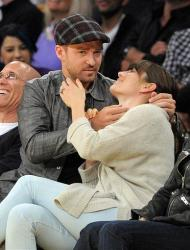 Justin Timberlake, left, looks up after kissing Jessica Biel as they watch the Los Angeles Lakers play the Denver Nuggets, Saturday, May 12, 2012, in Los Angeles.