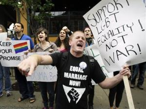 In this June 23, 2009 file photo, Keegan O'Brien of Worcester, Mass., leads chants as members of the LGBT community protest the Defense of Marriage Act.
