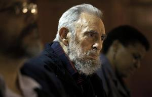 In this Feb. 10, 2012, file photo released by the state media website Cubadebate, Fidel Castro attends a meeting with intellectuals and writers at the International Book Fair in Havana, Cuba.