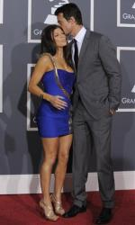 Fergie and husband Josh Duhamel arrives at the Grammy Awards on Sunday, Jan. 31, 2010, in Los Angeles.