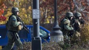 Police and swat team members respond to a call of a shooting at the Azana Spa in Brookfield, Wis. Sunday , Oct. 21, 2012.