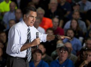 In this Oct. 10, 2012 file photo, Mitt Romney gestures during a town hall meeting at Ariel Corporation in Mt. Vernon, Ohio.