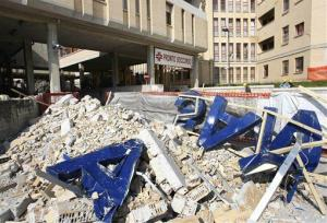 Rubble is seen outside the entrance of the Emergency Room of the San Salvatore Hospital, in L'Aquila, central Italy, in this Wednesday April 15, 2009 photo.