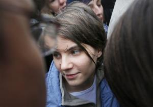Pussy Riot member Yekaterina Samutsevich stands surrounded by press outside a court in Moscow, Wednesday Oct. 10, 2012.