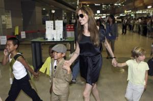 Angelina Jolie and her children, from left, 8-year-old Maddox, Zahara Marley, 6, Pax Thien, 6, and Shiloh Nouvel, 4, arrive at Narita International Airport in Narita near Tokyo Monday, July 26, 2010.
