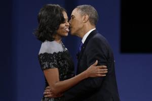President Barack Obama kisses his wife Michelle after the third presidential debate at Lynn University, Monday, Oct. 22, 2012, in Boca Raton, Fla.