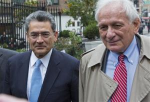 Former Goldman Sachs and Procter & Gamble Co. board member Rajat Gupta, center, arrives outside federal court in New York Wednesday, Oct. 24, 2012.