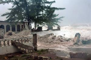 Waves brought by Hurricane Sandy crash on a house in eastern Kingston, Jamaica, Wednesday.