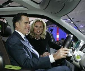 Mitt Romney sits in the Ford Explorer America concept as his wife Ann watches at the North American International Auto Show, Jan. 14, 2008, in Detroit.