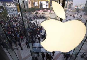 Chinese people line up to enter a newly opened Apple Store in Wangfujing shopping district in Beijing Saturday, Oct. 20.
