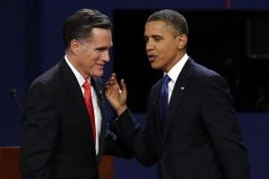 In this Oct. 3 file photo, Mitt Romney and President Obama talk after the first presidential debate.