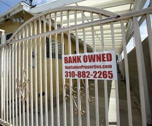 A bank owned sign is seen on a home that is listed as a foreclosure on a HUD website, in Hawthorne, Calif., July 21, 2010.