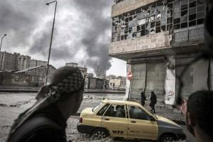 In this Thursday, Oct. 25, 2012 photo, smoke rises from the Karmal Jabl neighborhood, during clashes between rebel fighters and the Syrian army in Aleppo, Syria.