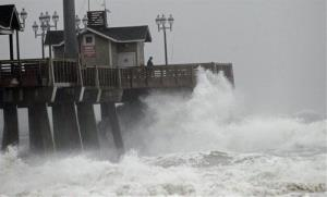 Large waves generated by Hurricane Sandy crash into Jeanette's Pier in Nags Head, NC, Saturday, Oct. 27, 2012 as the storm moves up the east coast.