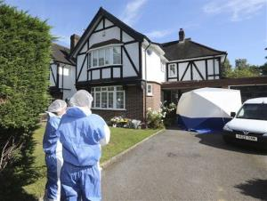 British police forensic officers Saturday Sept. 8, 2012, outside the home of Saad al-Hilli, in Claygate, Britain.