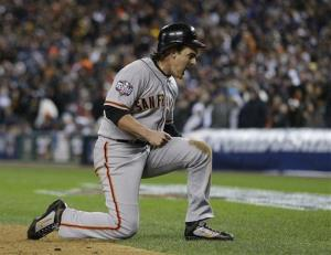 San Francisco Giants' Ryan Theriot reacts after scoring on an RBI single by Marco Scutaro during the10th inning.