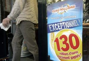 A man holds his Euromillions tickets in Paris, Sept. 26, 2008.
