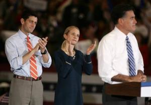 Republican vice presidential candidate, Rep. Paul Ryan of Wisconsin, and his wife Janna applaud as Republican presidential candidate, former Massachusetts Gov. Mitt Romney speaks during a campaign rally at the Marion County Fairgrounds in Marion, Ohio on Sunday, Oct. 28, 2012. The storm on the East Coast caused Mitt Romney...
