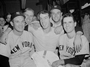 This is an Oct. 5, 1950 file photo showing Joe DiMaggio, flanked by teammates.