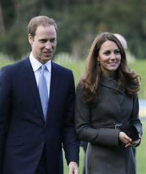 Britain's Prince William, left, and his wife Kate, the Duchess of Cambridge, visit a football training pitch at St George's Park near Burton Upon Trent in Staffordshire, England, Oct. 9, 2012.