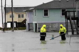 Dare County utility workers check on conditions along a flooded Ride Lane in Kitty Hawk, N.C., Monday, Oct. 29, 2012.
