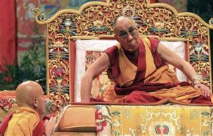 Tibetan spiritual leader the Dalai Lama listens to French Buddhist Matthieu Ricard, left, in Toulouse, France, Saturday, Aug. 13, 2011.