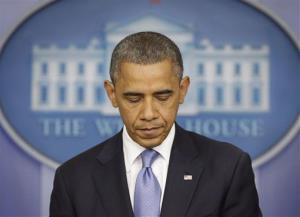 President Barack Obama pauses  in the White House Briefing Room in Washington, Monday, Oct. 29, 2012.