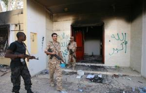 Libyan military guards check one of the burnt-out buildings following the September 11 attack in Benghazi.