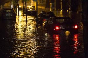 Vehicles are submerged during a storm surge near the Brooklyn Battery Tunnel, Monday, Oct. 29, 2012, in New York. Superstorm Sandy zeroed in on New York's waterfront with fierce rain.