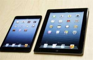 The iPad mini, at left, is shown next to the 4th generation iPad in San Jose, Calif., Tuesday, Oct.  23, 2012. The device has a screen that's about two-thirds the size of the full-size model, and Apple says it will cost $329 and up.