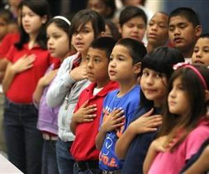 Students at Kostoryz Elementary School recite the pledge of allegiance in Corpus Christi, Texas, in this file photo.