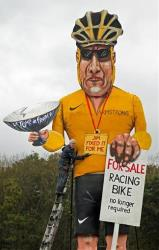 Artist Frank Shepherd poses with his creation of Lance Armstrong in Edenbridge, England.