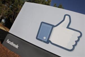 The Facebook logo is displayed outside of Facebook's headquarters in Menlo Park, Calif., Thursday, Jan. 12, 2012.