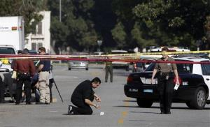 A Los Angeles Police Department investigator checks the site of a previous crime at the University of Southern California.