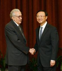 The UN-Arab League envoy to Syria Lakhdar Brahimi, left, shakes hands with Chinese Foreign Minister Yang Jiechi prior to their meeting at the Ministry of Foreign Affairs in Beijing, China, yesterday.