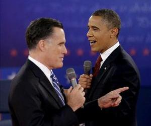 Barack Obama and Mitt Romney exchange views during the second presidential debate at Hofstra University in Hempstead, NY, in this Oct. 18, 2012 file photo.