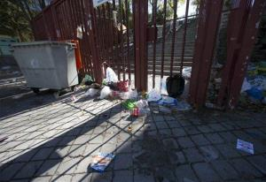 Empty bottles and other debris lie outside the closed gates of the Madrid Arena venue in Madrid, earlier today. Three women died and two injured in a stampede during a large Halloween Night party at the venue.