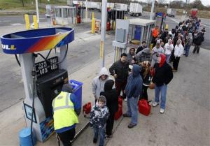 People line up to fill gas containers at the New Jersey Turnpike's Thomas A. Edison service area Wednesday, Oct. 31, 2012.