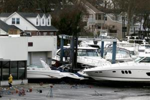 Boats are piled onto each other after Sandy washed them off their stands in Brick, N.J.