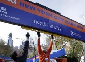 Workers assemble the finish line for the New York City Marathon in New York's Central Park,  Thursday, Nov. 1, 2012.