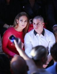Jennifer Lopez and her boyfriend Casper Smart sit in the front row for Valentino's ready to wear Spring-Summer 2013 collection, presented in Paris, Tuesday, Oct.2, 2012.