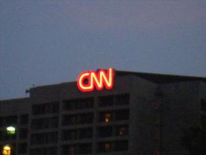 CNN Center in Atlanta received a bomb threat before dawn this morning, as an unidentified man demanded $15,000 or he would explode a chemical bomb.